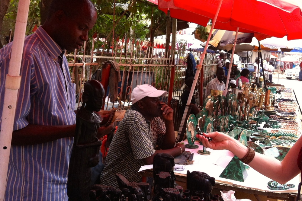 (September 2013) Buying trinkets at an outdoor market in Lubumbashi
