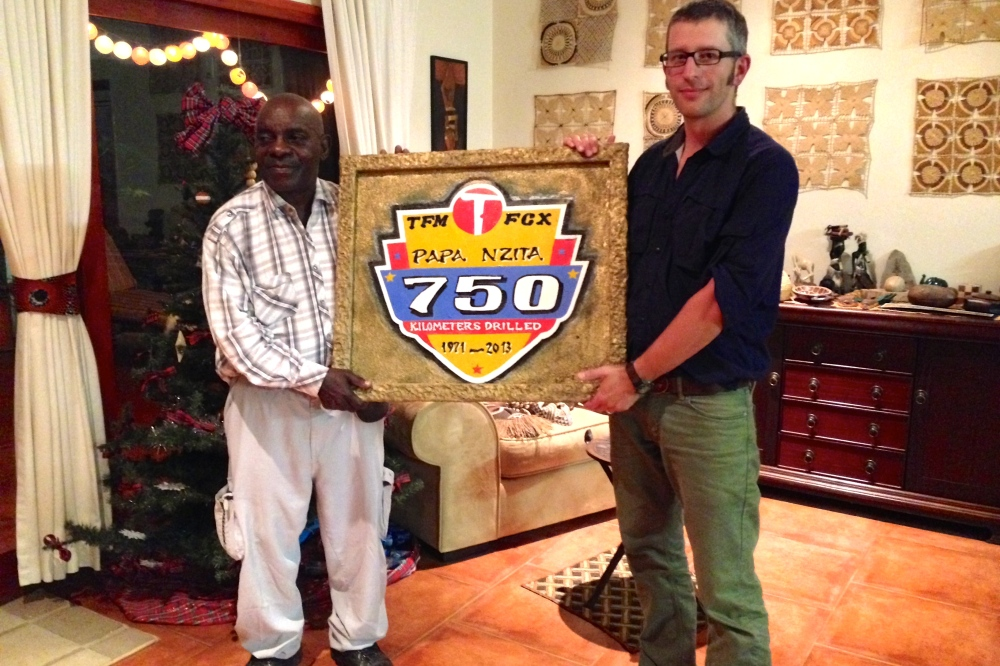 (December) Celebrating Papa Nzita's birthday at our place, with a plaque Seb had made commemorating his lifetime achievement in exploration drilling