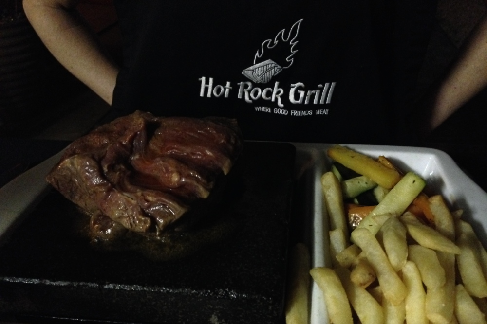 (February) Valentine's Day dinner at the former company-sponsored South African restaurant about 30 minutes away, where you could cook your steak on a hot stone
