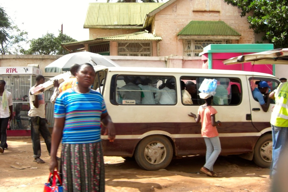 Catching a minibus taxi -- never a seat to spare.