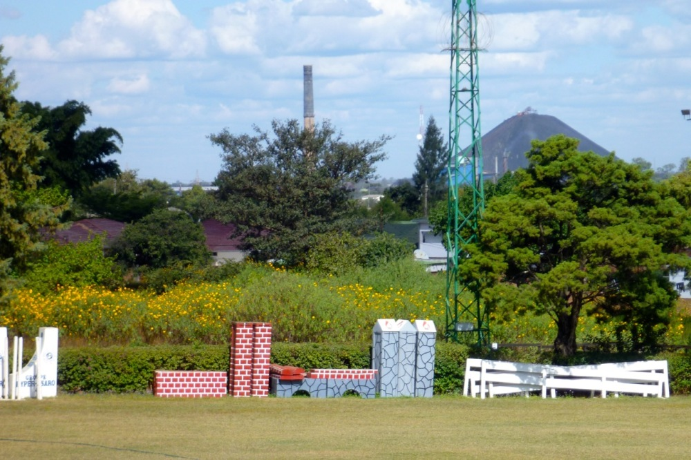 """Mount Lubumbashi""—the slag pile from an old copper smelter—with the horse-riding grounds of the Equestrian Club in front."