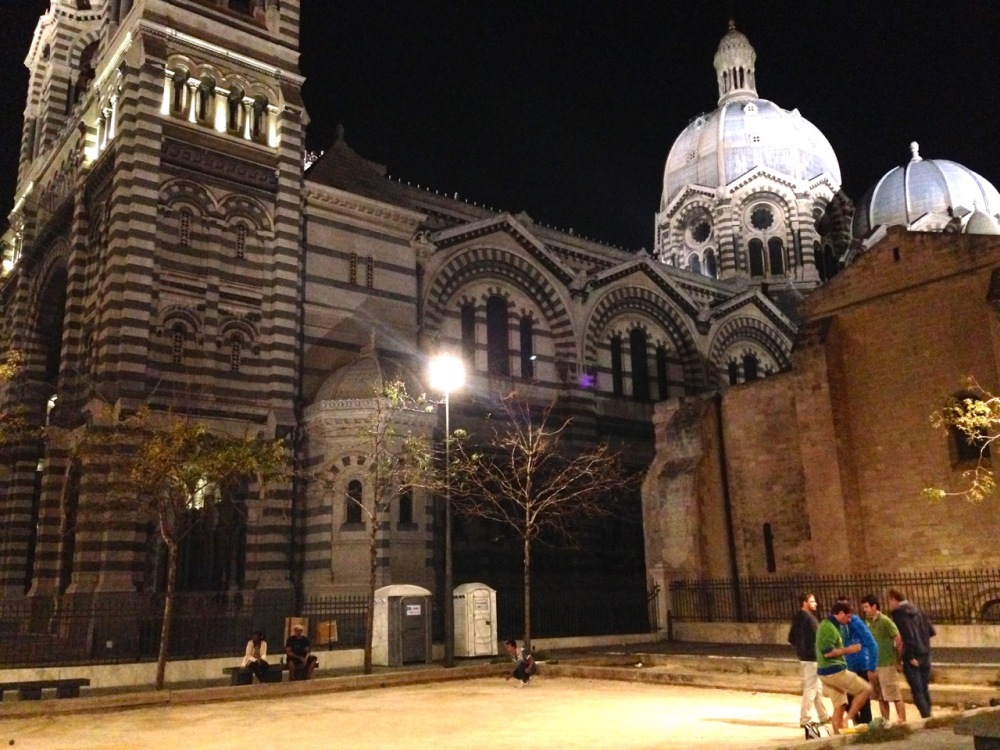 playing pétanque by night at the Marseille Cathedral