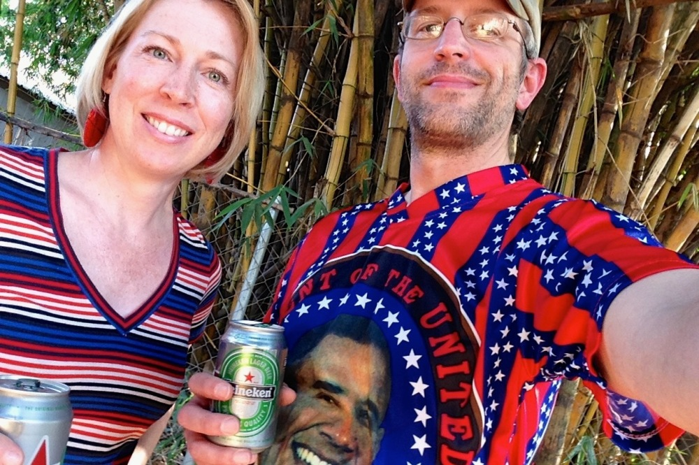 (July 2015) Seb and I celebrating USA's independence day with beer, hot dogs, and crazy fashion purchased in Fungurume back in 2010.