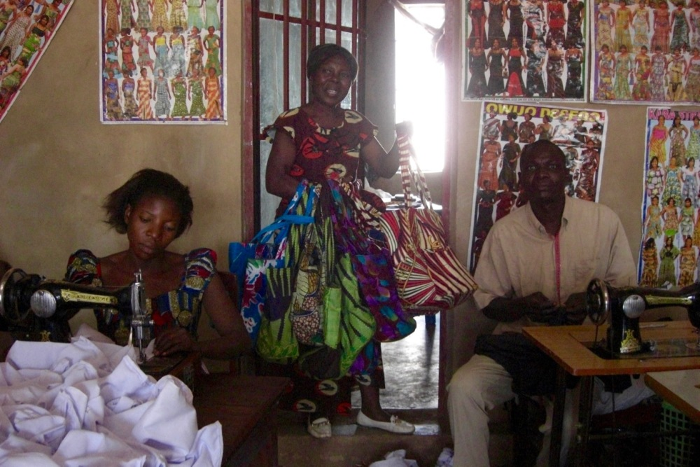 Later in 2011 I took the other ladies to meet the tailors, and we've been giving them business (dresses, purses, bags, etc.) ever since. (This woman in particular has a beautiful face that reminds me of my grandma...)