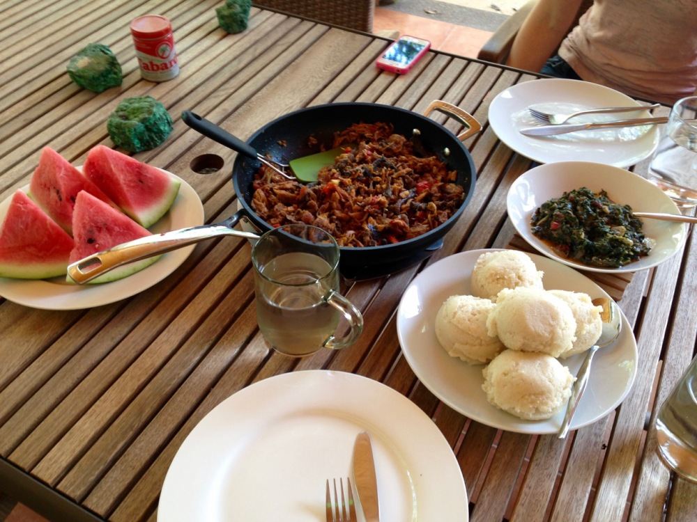 fufu with lenga-lenga, the dried fish, and watermelon, which is a rare find around here -- Viviane had never had it before
