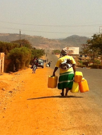 Heading to the well, water jugs in tow.