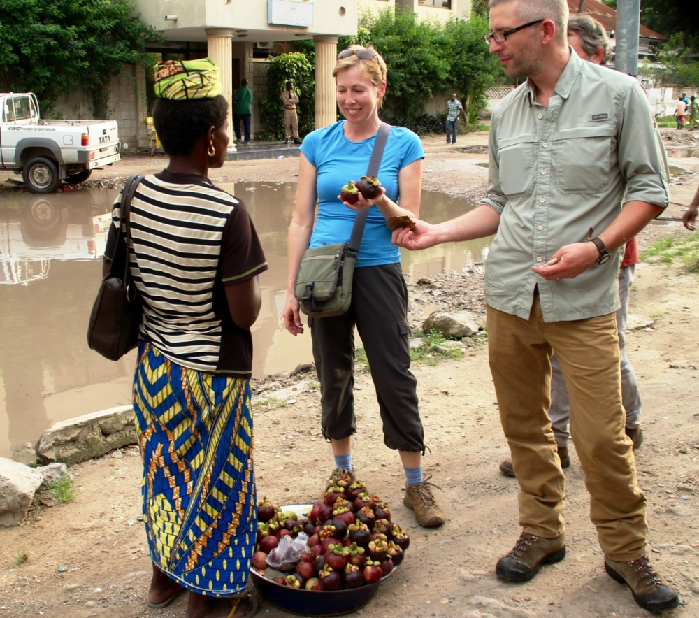 A photo from our friends Colleen & Ross, of us buying mangosteens.