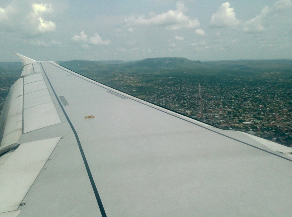First impressions of the city as seen from the air: lots of pretty hills all around, lots of trees, long wide streets, doesn't look bad at all. (These impressions would turn out to be both true and false.) On the other side of the plane we could spot our reason for coming: The Congo River!