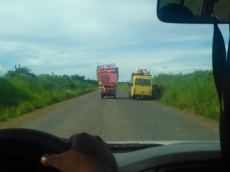 "March 2016: A road scene between Lubumbashi and Fungurume upon our return. This is ""national highway #1,"" nicely paved in most spots but still a hazardous drive. Overloaded vehicles and random potty breaks are the norm."