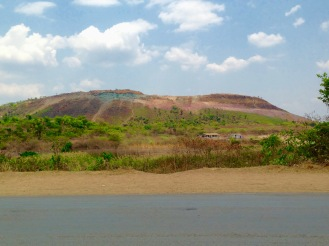 October 2015: A disappearing mountain near the former Green Wall, richly colored with malachite (green) and iron oxide (lilac)